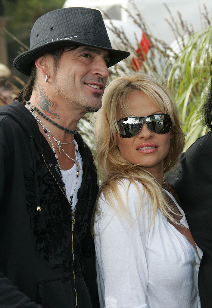 MALIBU, CA - DECEMBER 24:  (US TABS AND HOLLYWOOD REPORTER OUT) Musician Tommy Lee and actress Pamela Anderson pose at the home of John Paul DeJoria, CEO and co-founder of John Paul Mitchell Haircare Systems, during his annual party to thank movie, television and music star friends and his co-workers for their charitable work on December 24, 2005 in Malibu, California.  (Photo by David Livingston/Getty Images)
