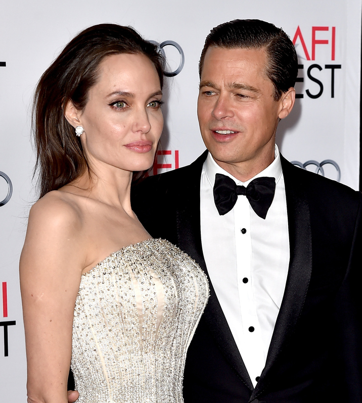 "LOS ANGELES, CA - NOVEMBER 05:  Actress/director Angelina Jolie Pitt (L) and husband actor Brad Pitt arrive at the AFI FEST 2015 presented by Audi opening night gala premiere of Universal Pictures' ""By The Sea"" at the Chinese Theatre on November 5, 2015 in Los Angeles, California.  (Photo by Kevin Winter/Getty Images)"