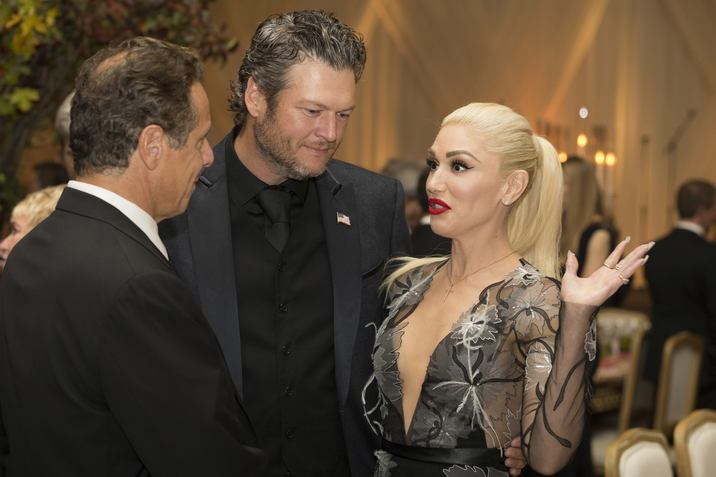 US entertainer Gwen Stefani (R), US entertainer Blake Shelton (C) and New York Governor Andrew Cuomo (L) attend a state dinner for Italian Prime Minister Matteo Renzi, hosted by US President Barack Obama, on the South Lawn of the White House in Washington DC, USA, 18 October 2016. President Obama hosts his final state dinner, featuring celebrity chef Mario Batali and singer Gwen Stefani performing after dinner. Photo Credit: Shawn Thew/CNP/AdMedia