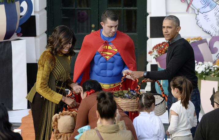 U.S. President Barack Obama and first lady Michelle Obama hand out treats during a Halloween event at the South Lawn of the White House October 31, 2016 in Washington, DC. The first couple hosted local children and children of military families for trick-or-treating at the White House.Photo by Olivier Douliery/UPI