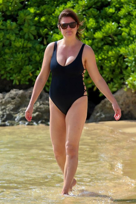 """AG_153244 - *PREMIUM-EXCLUSIVE* - *PREMIUM EXCLUSIVE* Oahu, HI - Actress Tiffani-Amber Thiessen proves she still has it as she stuns in a one-piece black bathing suit during her stay at the Aulani Disney Resort. The former """"Saved By the Bell"""" heartthrob cooled off in the water for a beach day during a family break for the Thanksgiving weekend. **SHOT ON 11/27/16** AKM-GSI 29 NOVEMBER 2016To License These Photos, Please Contact : Maria Buda (917) 242-1505 mbuda@akmgsi.com or Mark Satter (317) 691-9592 msatter@akmgsi.com sales@akmgsi.com"""