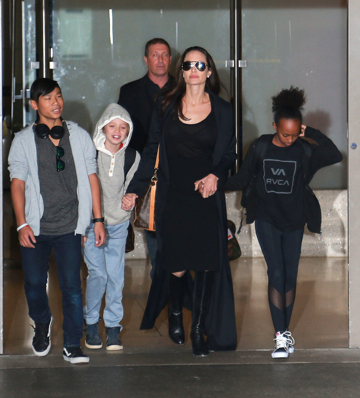 51985748 Actress Angelina Jolie and her kids Pax, Shiloh and Zahara are seen arriving on a flight at LAX airport in Los Angeles, California on March 2, 2016. The family was returning from Cambodia where Angelina spent the last 3 months filming the documentary 'First They Killed My Father'. FameFlynet, Inc - Beverly Hills, CA, USA - +1 (310) 505-9876