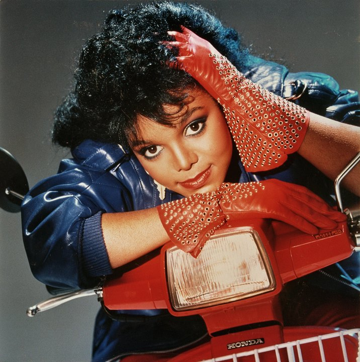 """LOS ANGELES - 1984:  Singer and actress Janet Jackson poses for her """"Dream Street"""" album cover in 1984 in Los Angeles, California. (Photo by Harry Langdon/Getty Images)"""