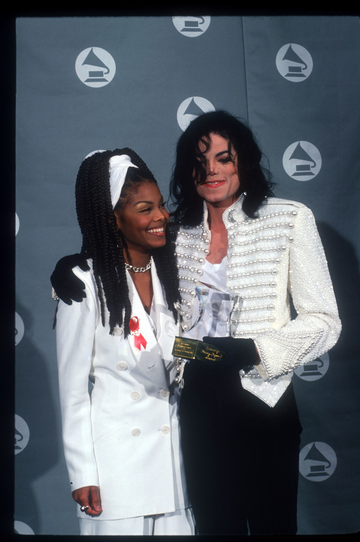 150787 08: Michael Jackson smiles with his sister Janet Jackson at the Grammy Awards February 26, 1993 in Los Angeles, CA. Jackson was presented with the Legend Award for his continuing contributions and influence in the recording field. (Photo by John Barr/Liaison)