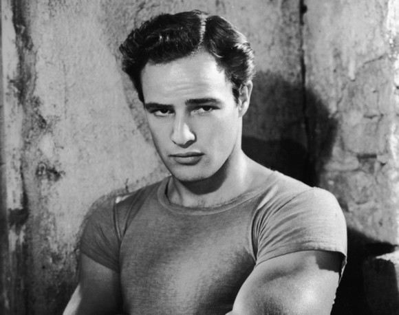 Promotional portrait of American actor Marlon Brando with his arms folded, circa 1951. (Photo by Hulton Archive/Getty Images)