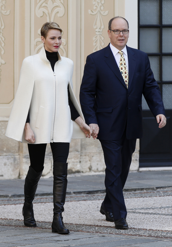 Prince Albert II of Monaco and his wife Princess Charlene arrive for the Children's Christmas ceremony at the Monaco Palace on December 16, 2015. / AFP / VALERY HACHE