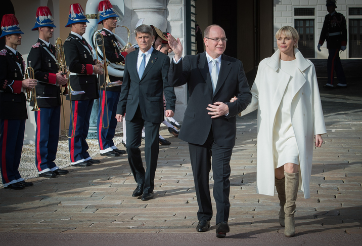 MONACO - JANUARY 07:  Princess Charlene of Monaco and Prince Albert II of Monaco wave to the crowd during the official presentation of the Monaco twins on January 7, 2015 in Monaco, Monaco.  (Photo by Monaco Princely Pool/WireImage)