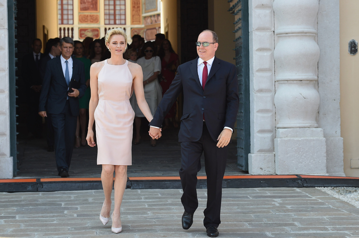 MONACO - JULY 11:  Princess Charlene of Monaco and Prince Albert II of Monaco walk on the Palace Place during the First Day of the 10th Anniversary on the Throne Celebrations on July 11, 2015 in Monaco, Monaco.  (Photo by PLS Pool/Getty Images)