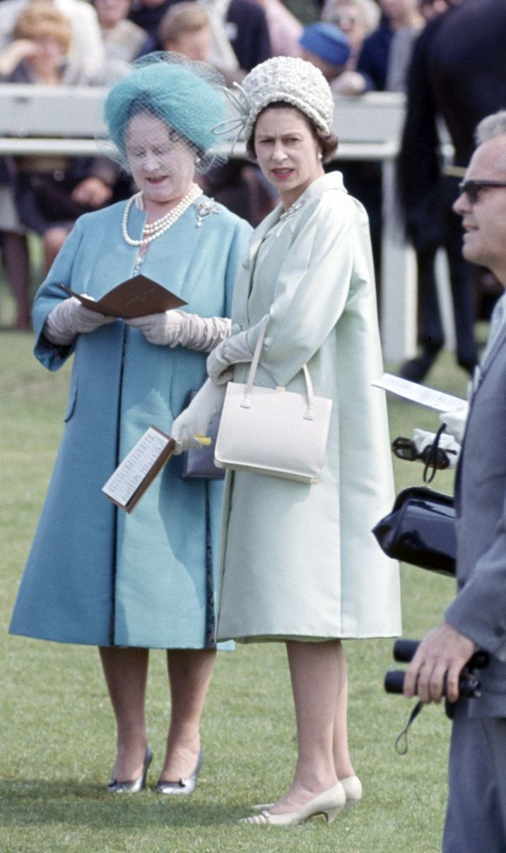 The Queen Mother (left) and Queen Elizabeth II in the parade ring at the Epsom Derby in Surrey, on 2nd June 1965. (Photo by Ray Bellisario/Popperfoto/Getty Images)