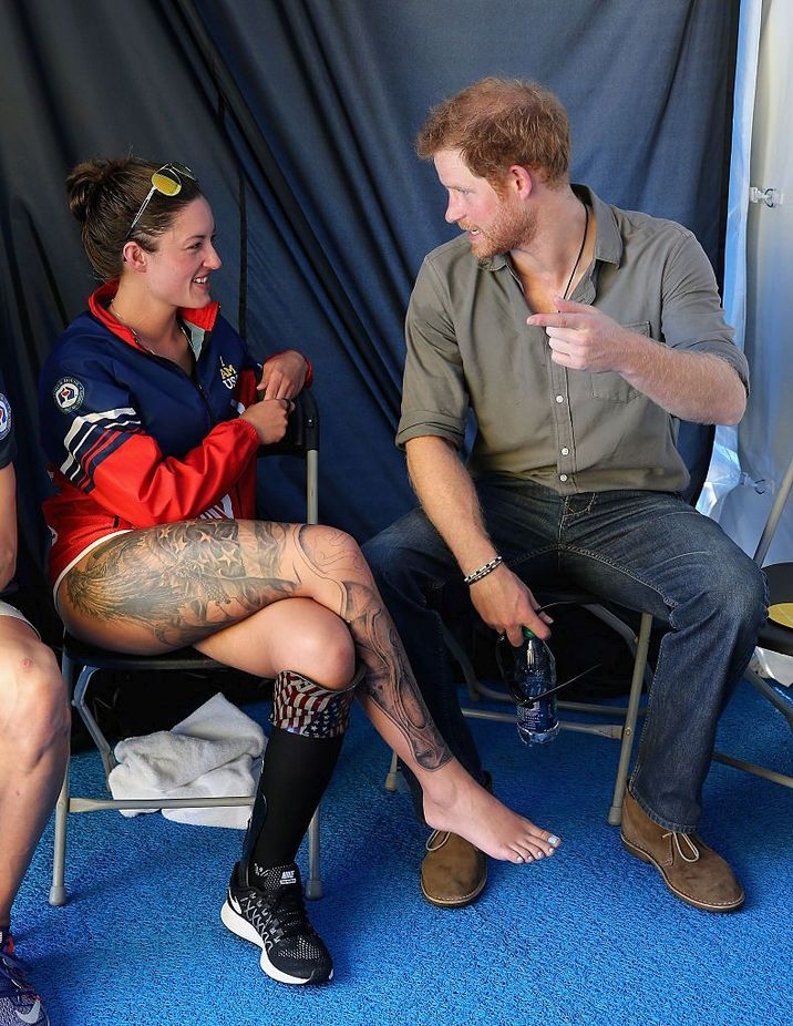 ORLANDO, FL - MAY 11:  Prince Harry chats with USA Invictus Team Member Elizabeth Marks in the competitor's tent at the swimming pool during the Invictus Games Orlando 2016 at ESPN Wide World of Sports on May 11, 2016 in Orlando, Florida. Prince Harry, patron of the  Invictus Games Foundation is in Orlando for the Invictus Games 2016. The Invictus Games is the only International sporting event for wounded, injured and sick servicemen and women. Started in 2014 by Prince Harry the Invictus Games uses the power of Sport to inspire recovery and support rehabilitation.  (Photo by Chris Jackson - WPA Pool /Getty Images for Invictus)
