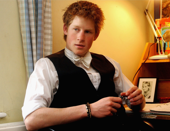 WINDSOR, ENGLAND - MAY 2003: (FILE PHOTO) Prince Harry relaxes in his room at Eton College in March 2003.in Windsor, England. The Royal Family on October 9, 2004 denied allegations that the Prince had cheated in his art A-level.  Sarah Forsyth, a former teacher of Harry at Eton, made the allegations as she prepared to take the college to an industrial tribunal claiming for unfair dismissal. (Photo by Anwar Hussein/Getty Images)