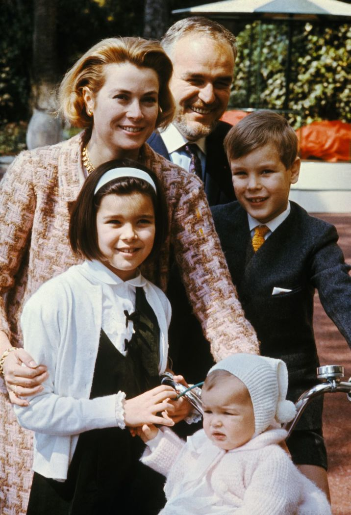 (Original Caption) Posing in the Garden of their palace Prince Rainier and Princess Grace, who will mark their 10th wedding anniversary, April 18, are shown with their youngsters Princess Stephanie, 14 months, Princess Caroline, 9, and Prince Albert, 8.