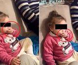 Imagini revoltatoare! O fetita de 2 ani din Tulcea, fortata de parinti sa bea si sa fumeze