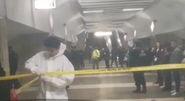 Filmul crimei de la metrou. Oamenii legii au prins-o pe femeia suspecta in fata unui magazin din Piata Unirii