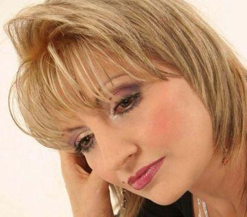 Problemele pe care le intampina Elena Merisoreanu dupa moartea Ilenei Ciuculete! Cantareata a facut o operatie la ochi si nu avea voie sa planga