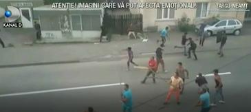 Un singur politist a fost lasat sa infrunte 50 de romi, care se razboiau in strada, cu topoare si cu scanduri
