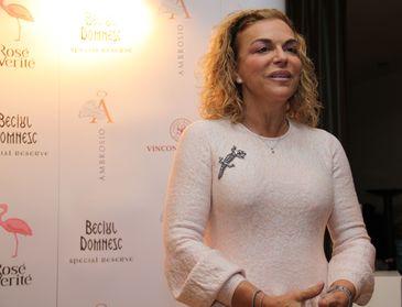 Fosta iubita a lui Gigi Netoiu castiga milioane de euro din vinuri si mezeluri! Luchi Georgescu este considerata una dintre cele mai influente femei din Romania!