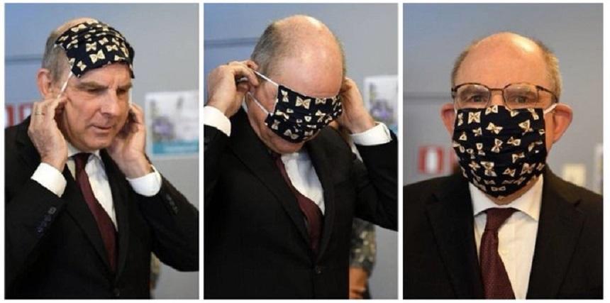 Imagini cu vicepremierul belgian încercând fără prea mare succes să-şi pună o mască au devenit virale. Opozanţii: Cea mai bună ilustrare a modului în care guvernul a gestionat criza coronavirusului. Scriitoarea JK Rowling i-a luat apărarea - VIDEO