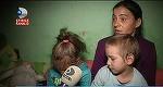 Drama unei mame din Cluj care isi creste cei doi copii cu...iubire. Nu are nici bani sa ii incalzeasca la iarna, nici ce sa le dea sa manance